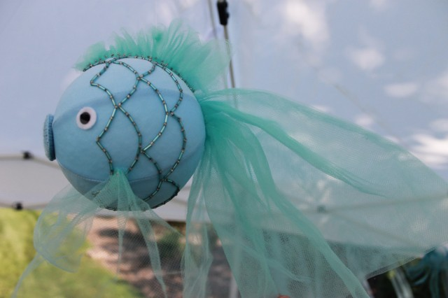 ... blue tulle hanging over the blue picnic table to create the under the